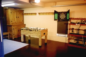 Foosball table darts and bootwarmers in garage